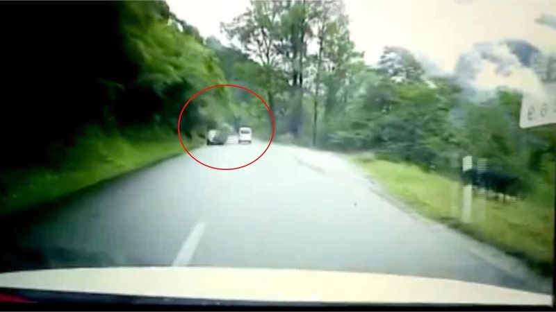 Car hit by huge boulder rolling down the side of a mountain