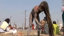 Sadhu applies human ash on his body during Kumbh Mela India