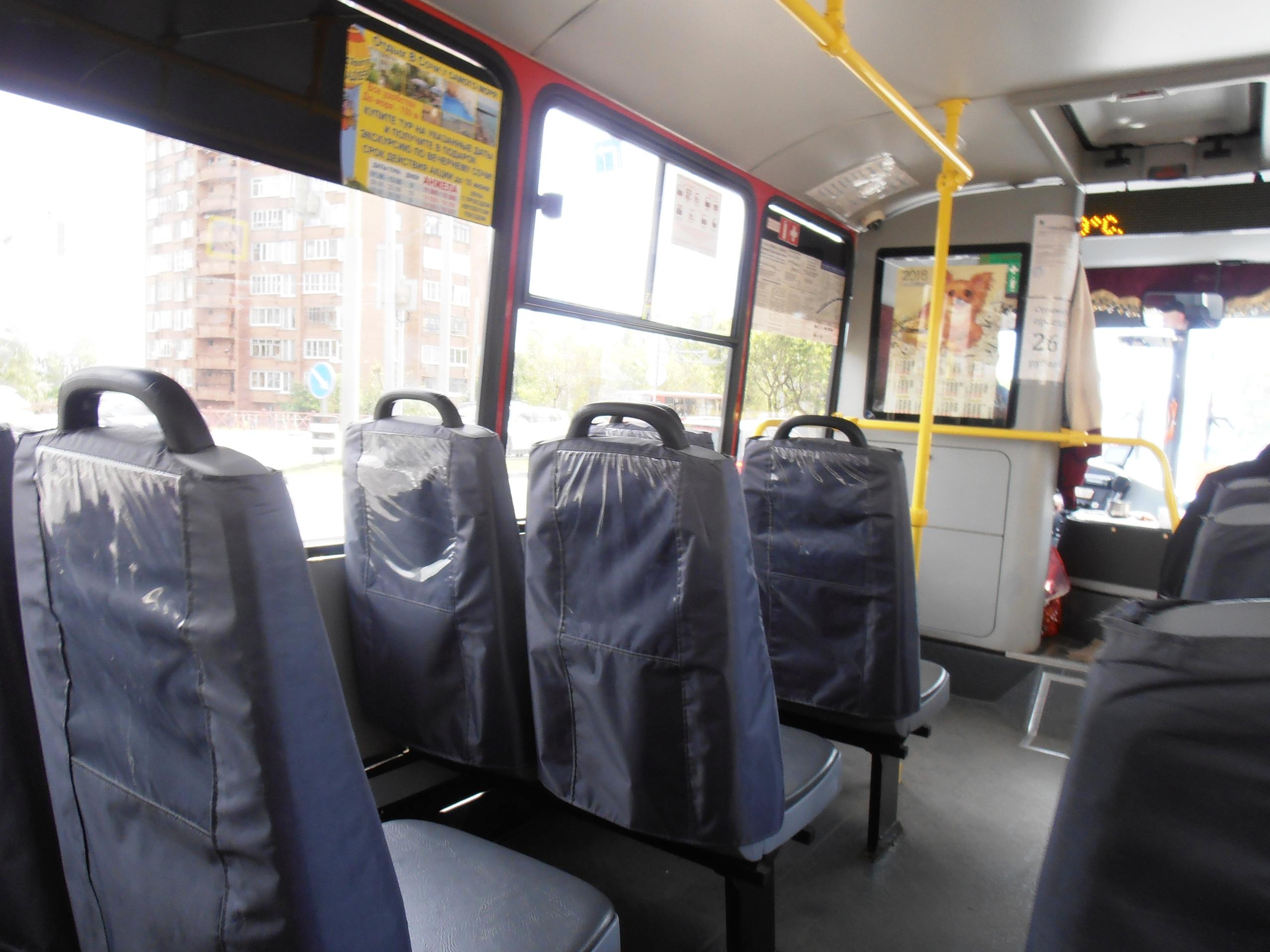 Внутри салона автобуса..