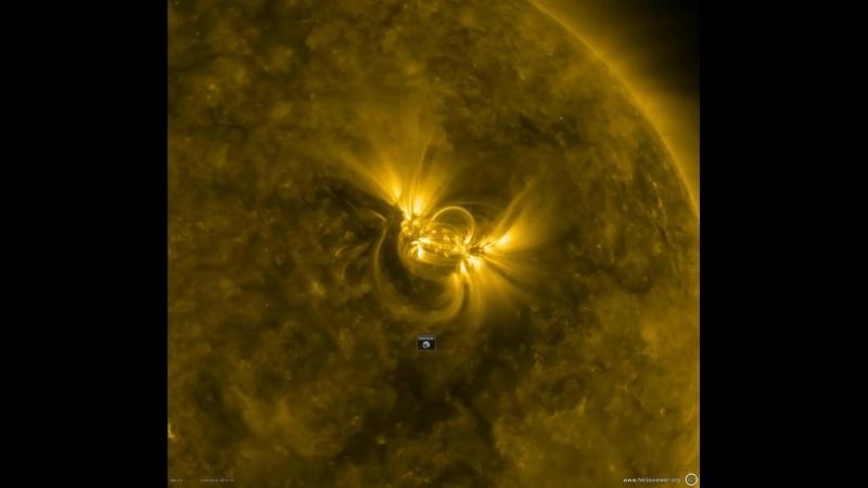 Это видео показывает большой солнечный активный регион с яркими магнитные линиями перехода и скручивания над ним Активные реги