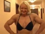 woman in bed with man arm wrestling   bodybuilding
