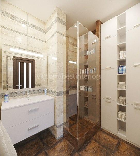 Ванная комната с душевой, выполненная в тёплых тонах. В отделке использованы плитка под камень и зер… (3 фото) - картинка