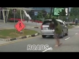 Lady jaywalker's feet run over by car ( 720 X 1280 ).mp4