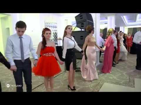 Slim busty romanian girl in white shirt dancing in wedding