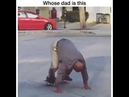 Dad does a one hand stand skateboard trick