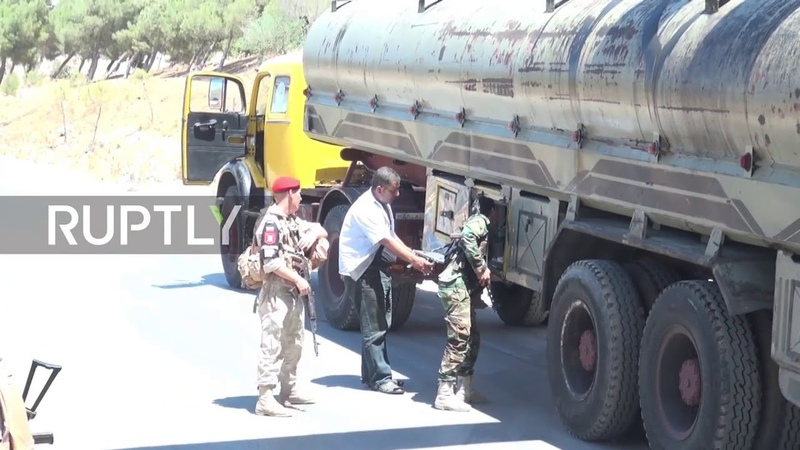 Syria Russian military man checkpoint in new 'de escalation' zone north of Homs