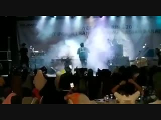 Tsunami wave crashes into a venue while a band performs in indonesia