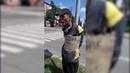 На Украине молодчики на глазах у людей привязали к дорожному знаку старика с табличкой Я ватник