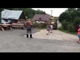 Человек на бульдозере давит людей и ломает гаражи