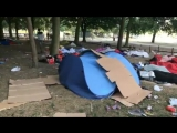 Brussels on a summer Sunday morning; Migrants living in parks. Trash everywhere.