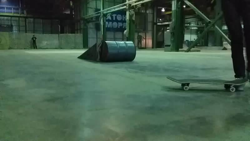 Ramses on skate tre flip of a kicker ramp over the lying barrel with hand 12 02 2019