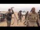 Иракские ополченцы после боя под Мосулом