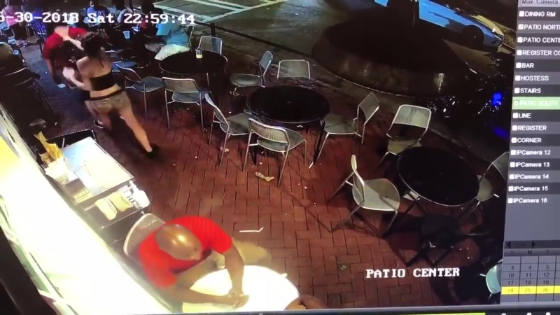 A man touches the buttocks of a waitress