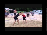 Beach women's wrestling. Beautiful females catch wrestling match (beach wrestling series)