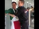 Мексиканского болельщика обыскивают полицейские.Mexican fan searched by police