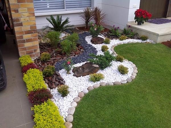 Украшение сада Интересные идеи использования цветной гальки и камня на даче