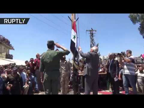 Syrian flag rises over Nawa after city freed from militant control