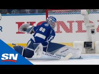 Andrei vasilevskiy pulls a behind-the-back glove save on mathew barzal