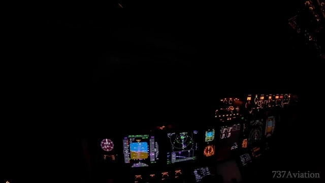Boeing 737 flying in the night
