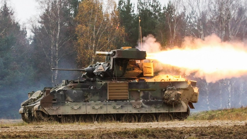 M2 BRADLEY FIGHTING VEHICLE IN ACTION • TOW MISSILES M242 FIRING
