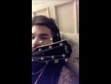 VIDEO @ adamlambert Snapchat making music wearing earphones )
