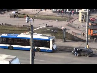 Unlucky Russian Driver trying to start a car with a trolleybus