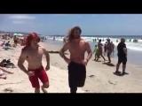 Brock O'Hurn on a beach