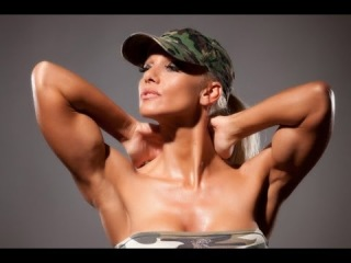 Female Muscle Csilla Fodor Biceps Flexing at Studio Photoshooting