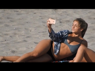 Teens in thong bikini tanning on the beach (Short video)