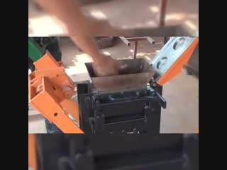 Startop interlocking brick machine