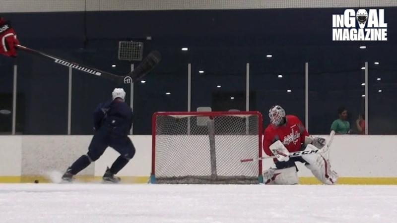 InGoal on ice with Braden Holtby of the Washington Capitals