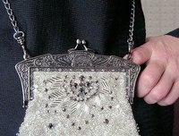Данный материал взят с сайта stitcher.ru Рубрика: Дамские сумочки - ридикюли, украшенные обложки и игольницы...
