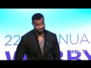 Isaiah Mustafa presents to David Harbour as Webby Best Actor at the 22nd Annual Webby Awards