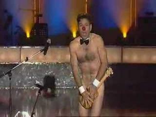 Man Plays Ukulele naked