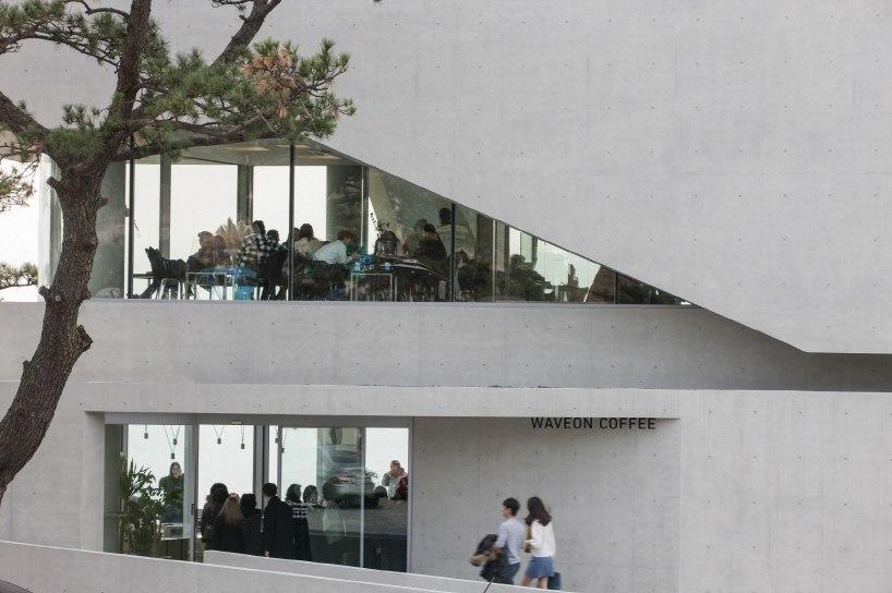IDMM architects' waveon café embraces the coastal scene of Gijang in Korea