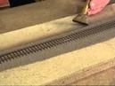 Ballasting HO flex track using a vacuum powered ballast machine