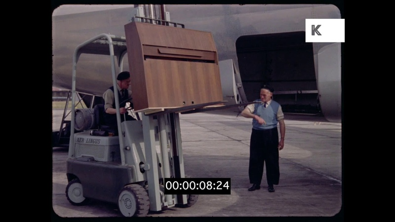 Loading Cargo Onto Plane at Airport, Ireland, 1950s, 1960s, 35mm