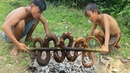 Primitive Technology: Two Brothers Catch Snake With Trap Near The Mountain - Catch n Cook