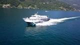 Freccia dei Giardini, fast hydrofoil passenger ship at Lago Maggiore, aerial view 4K