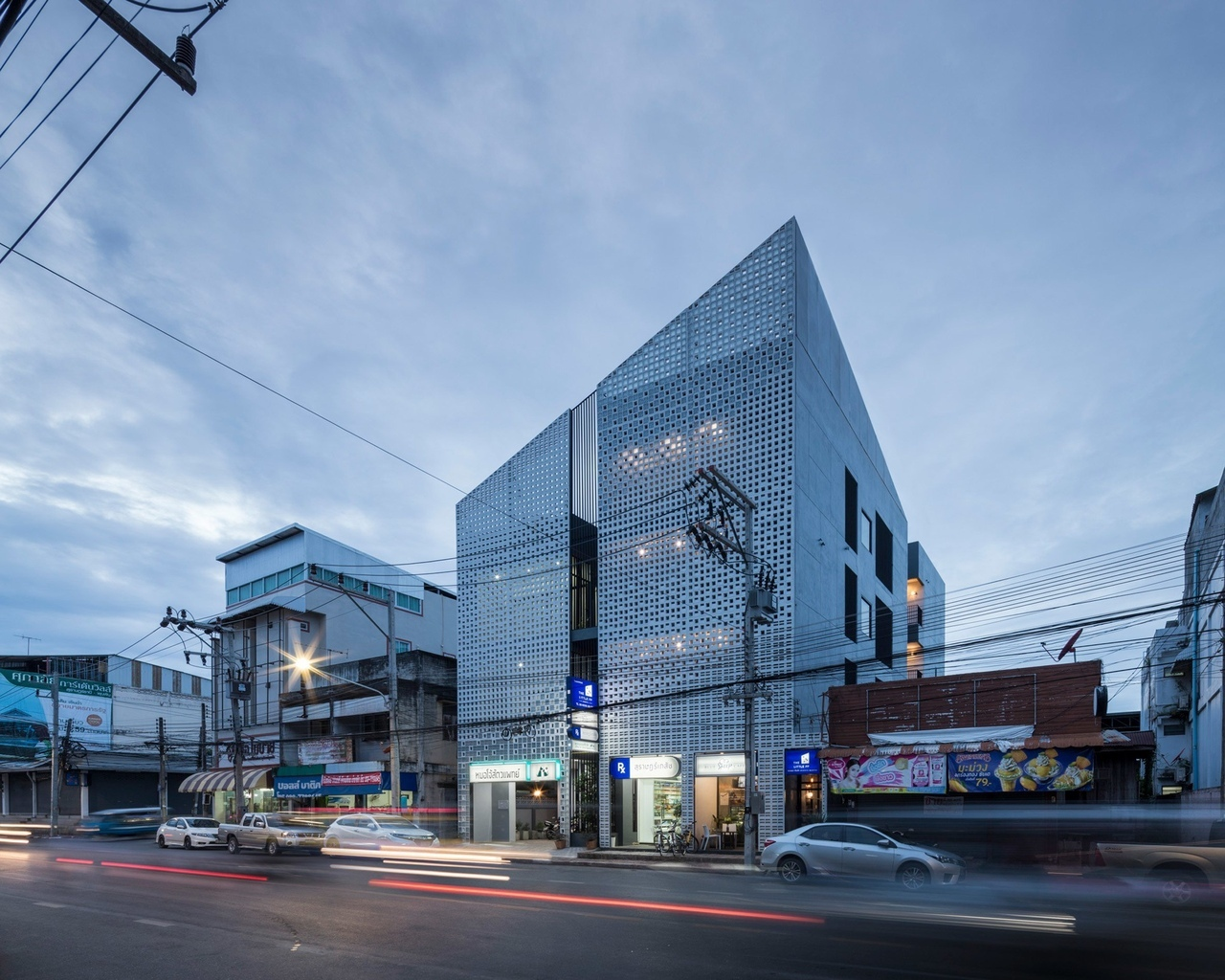 EKAR Architects designs concrete-block Thailand house for vet and pharmacist siblings