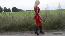 Blonde Manga girl wearing red latex catsuit in public