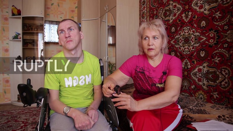 Russian mother carries wheelchair-bound son up and down stairs for 18 years