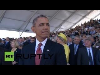 Годовщина высадки союзников в Нормандии стала первым международным мероприятием с начала событий на Украине, на котором присутствовали и Владимир Путин, и Барак Обама. Организаторы показали обоих лидеров на огромном дисплее, вынудив их обменяться улыбкам