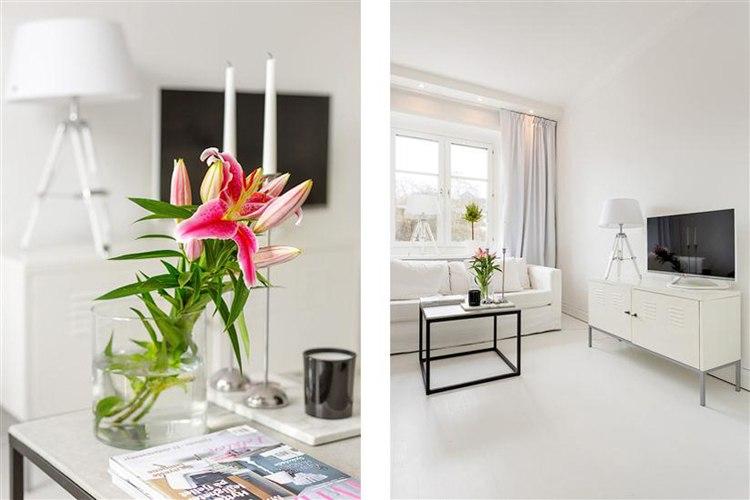 Белоснежная квартира-студия 23 м на севере Европы с кухней-нишей и встроенной подсветкой над окном.