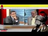 Kadir Misiroglu показывает в прямом эфире на телепередачи исторический архивный документ с личной подписью Камаля