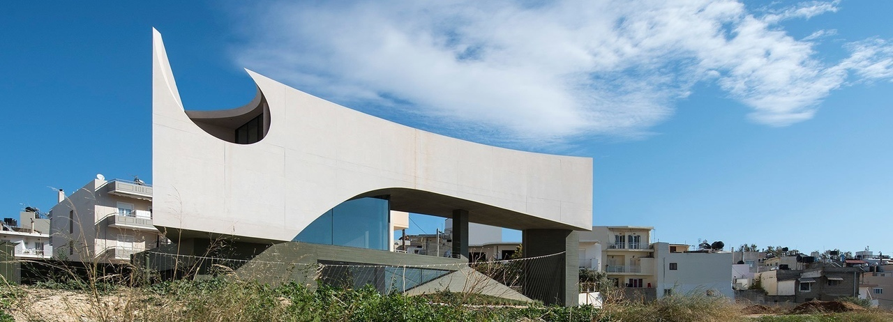 tense architecture network sculpts house in crete from sun angles
