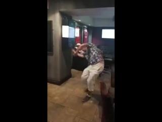 Drunk lad falls backwards in a pub