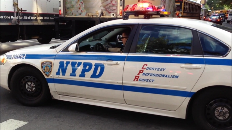 NYPD POLICE UNIT STUCK IN TRAFFIC THEN USES RUMBLER TO GET BY IN HELLS KITCHEN AREA OF MANHATTAN.