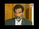WRAP Defiant Saddam Hussein appears in court for first time