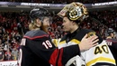 Bruins, Hurricanes shake hands and salute fans